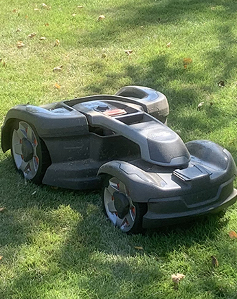 Robotic mower on green grass