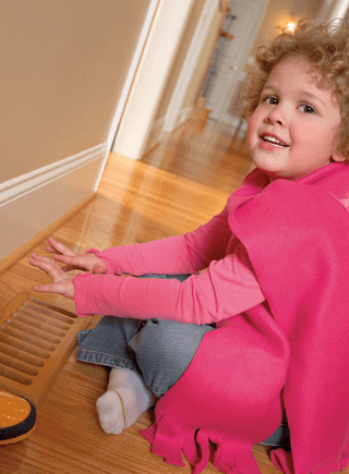 child playing in a hallway