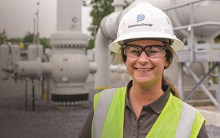 Smiling employee with helmet and goggles
