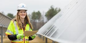 Employee near solar panels