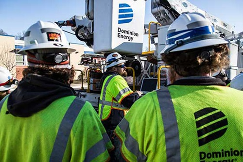 Dominion Employees and Truck - Who we are