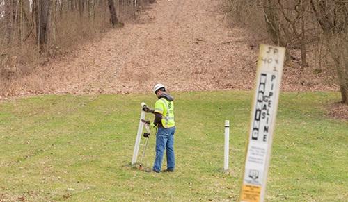 Employee marking gas line